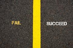 Antonym concept of FAIL versus SUCCEED - stock photo