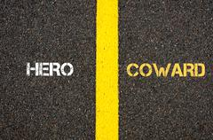 Stock Photo of Antonym concept of HERO versus COWARD
