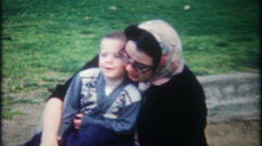 3179 mother & son share an intimate moment - vintage film home movie Stock Footage