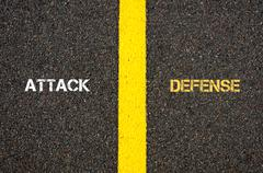 Antonym concept of ATTACK versus DEFENSE - stock photo