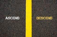 Antonym concept of ASCEND versus DESCEND Stock Photos