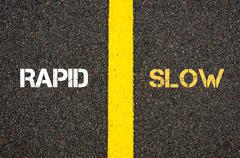 Antonym concept of RAPID versus SLOW - stock photo