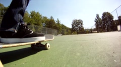 Semi professional skater does a board slide Stock Footage