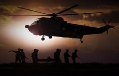 Military rescue helicopter during sunset Stock Photos