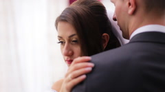 Beautiful bride feeling protected and really happy to hold her husband`s  hands - stock footage