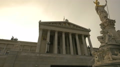 Bright sun at Parliament Building in Vienna at dawn Stock Footage