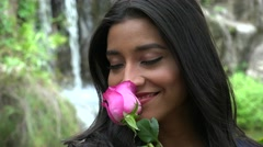 Pretty Hispanic Woman With Pink Flower Stock Footage