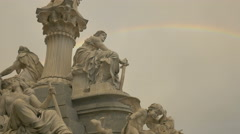 Pallas Athene Fountain and a rainbow at the Parliament Building, Vienna Stock Footage