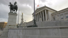 Taking pictures of the statues in front of the Parliament Building, Vienna Stock Footage