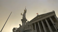 Goddess Athena statue in front of the Parliament Building in Vienna Stock Footage