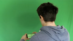Boy takes pictures with your mobile phone, Green Screen Stock Footage
