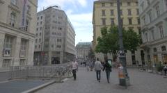 People walking on Heidenschuß, near the Am Hof square in Vienna Stock Footage