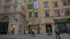 Walking on Naglergasse cross to Haarhof street, passing by DerMann Cafe, Vienna Stock Footage