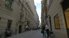 Tourists and locals walking on Naglergasse in Vienna Stock Footage