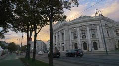 The Court Theatre seen on Universitätsring in Vienna at sunset Stock Footage