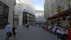 Walking on Bognergasse, passing by Prada store and a restaurant, Vienna Stock Footage