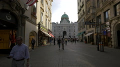 The Hofburg Palace seen from Kohlmarkt in Vienna in the afternoon Stock Footage