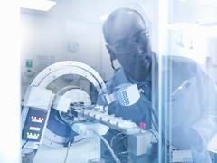 Stock Photo of Scientist in laboratory with analytical scientific equipment