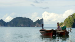 Two small fisher boats near the Phi Phi island, Krabi, Thailand Stock Footage