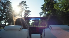 Two Happy Traveler Woman In Cabriolet Car - stock footage