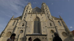 Low angle of people walking in front of Stephansdom, Vienna Stock Footage