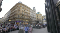 People walking and resting on Graben street in Vienna Stock Footage