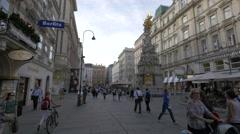Walkig by the Plague Column on Graben street in Vienna Stock Footage
