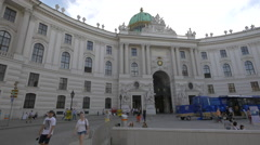 Bus parked in front of the Hofburg Palace in Vienna Stock Footage