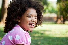Young girl wearing pink spotty top, portrait - stock photo