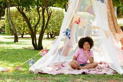 Girl sitting in summer netting tent Stock Photos
