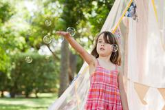 Young girl with bubble wand Stock Photos