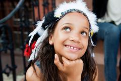 Girl in headdress smiling Stock Photos