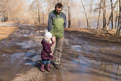Father and daughter walking in the forest - stock photo