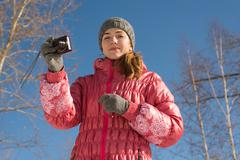 Portrait of a woman taking pictures - stock photo