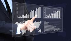 Businessman Touching a Graph Indicating Growth. business concept Stock Photos