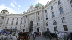 Horse carriages in front of the Hofburg Palace in Michaelerplatz, Vienna - stock footage