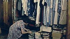 Austria 1963: woman working on her closet - stock footage