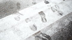 Snow texture with foot prints - stock footage