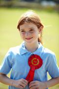 Smiling girl wearing first place ribbon Stock Photos
