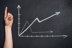 Growing graphs drawn on blackboard Kuvituskuvat