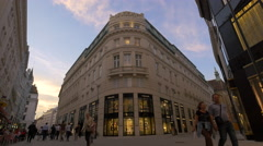 Walking by Prada clothing store seen on Bognergasse street in Vienna Stock Footage