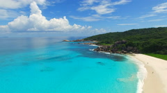 Aerial view of tropical paradise beach with white sand and crystal clear water. Stock Footage