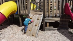 Child climbs a cliff simulator Stock Footage