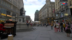 Woman playing piano and other people are walking on Graben in Vienna Stock Footage