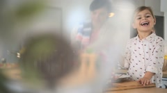 Mom and daughter cooking together in modern kitchen Stock Footage