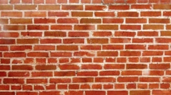 Movement along the wall of red brick - stock footage