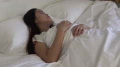 4k, Attractive asian woman lying in the bed -Dan Stock Footage