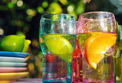 Stock Photo of Fruity drinks in colorful glasses