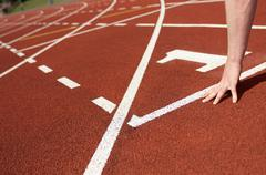 Close up of athlete's hand on track Stock Photos