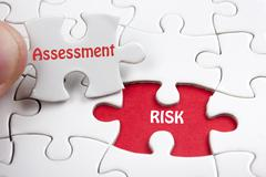 Risk Assessment. Missing jigsaw puzzle pieces with text - stock photo